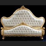 A Charles French Louis Style Bed In Gold Leaf and upholstered in an ivory fabric1