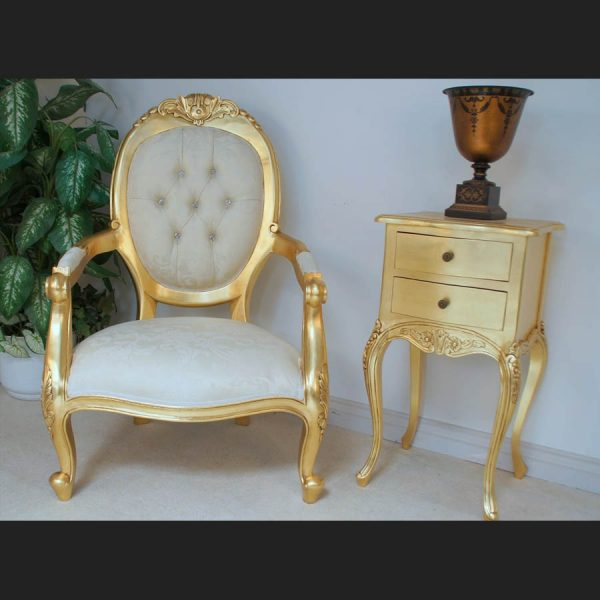 A Chatsworth arm throne chair in GOLD LEAF finish and cream fabric with crystal buttons