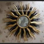 A Designers Large Star burst mirror in gold and black1