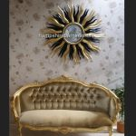 A Designers Large Star burst mirror in gold and black3