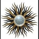 A Designers Large Star burst mirror in gold and black4