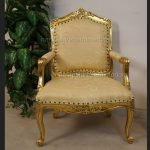 A Large Louis French Chair in gold leaf and gold fabric1
