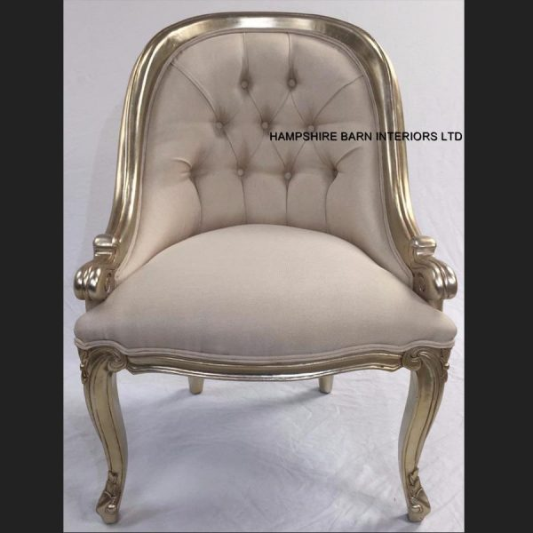 a-1-carlton-salon-tub-chair-shown-in-a-champagne-finish-and-upholstered-with-a-creamy-beige-linen-type-fabric