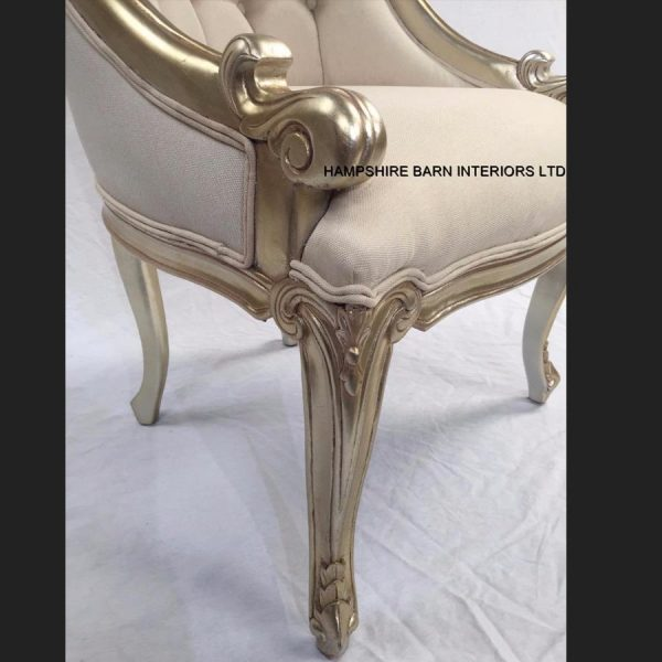 a-1-carlton-salon-tub-chair-shown-in-a-champagne-finish-and-upholstered-with-a-creamy-beige-linen-type-fabric2