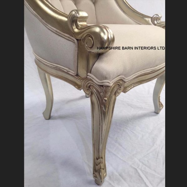 a-1-carlton-salon-tub-chair-shown-in-a-champagne-finish-and-upholstered-with-a-creamy-beige-linen-type-fabric4